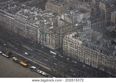Sudden snowstorm in spring in the French capital. View from Eiffel tower on rue Beethoven, avenue de New York, voie Georges Pompidou, port Debilly and Seine Rive. Paris. France