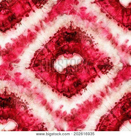 Seamless tie-dye pattern of pink and brown color on white silk. Hand painting fabrics - nodular batik. Shibori dyeing.
