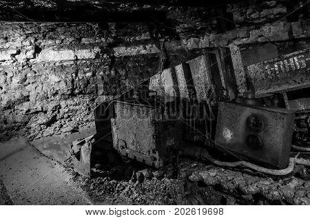 Old unused mining machinery underground in Estonia