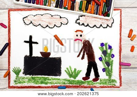 Photo of colorful drawing: Sad man and grave.