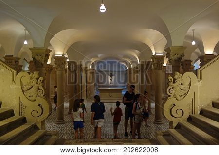 LECCE ITALY - JULY 27 2017: People in the Crypt under the Duomo dell Assunta Cathedral