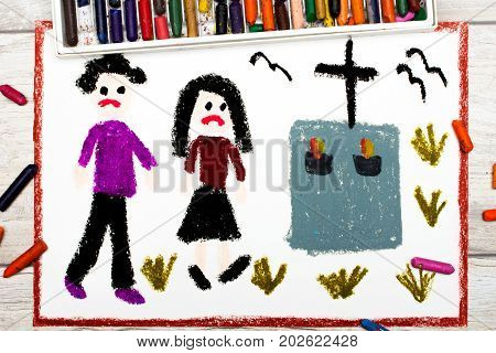 Photo of colorful drawing: Sad couple and grave.