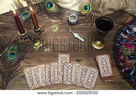 Tarot cards on wooden table. Fortune teller.