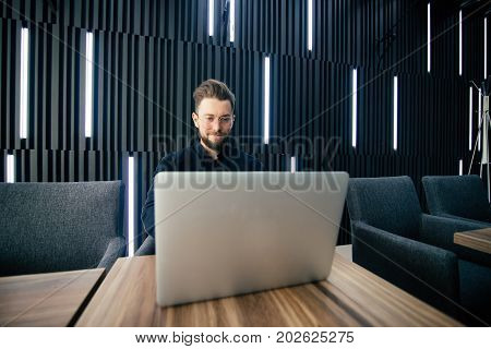 Successful Businessman Working On Laptop In Modern Luxury Office Desk. Young Entrepreneur Satisfied