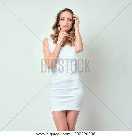 attractive brunette model girl pose in white clothes