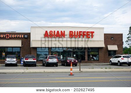 CADILLAC, MICHIGAN / UNITED STATES - JUNE 22, 2017: One may eat Chinese food at the Asian Buffet Restaurant, on Mitchell Street.