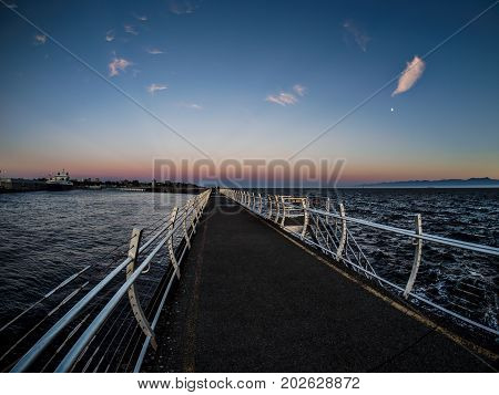 Breakwater at the Ogden Point in Victoria BC Canada; sunset time