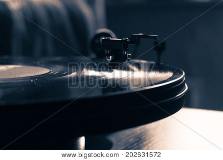 Vintage record player with vinyl disc, close-up.