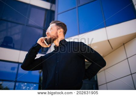 Portrait Of Handsome Bearded Businessman Talking Phone Standing Near Office