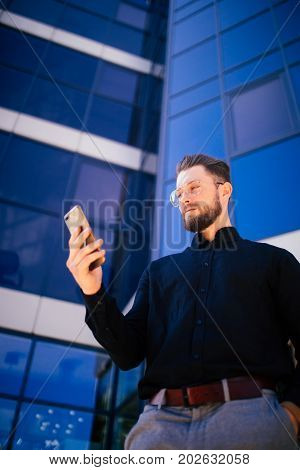 Happy Smiling Businessman Using Modern Smartphone Near Office , Successful Employer To Make A Deal W
