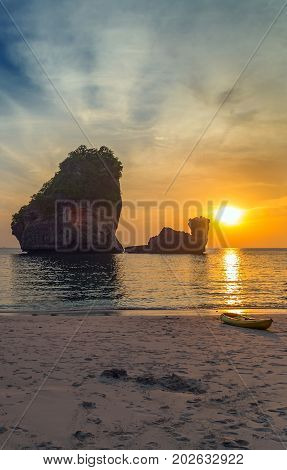Sunset sand Beach Nui Bay Thailand Krabi province Andaman sea, Fantastic dreamy sunrise, bright blue skies and colorful clouds, landscape at sunrise.