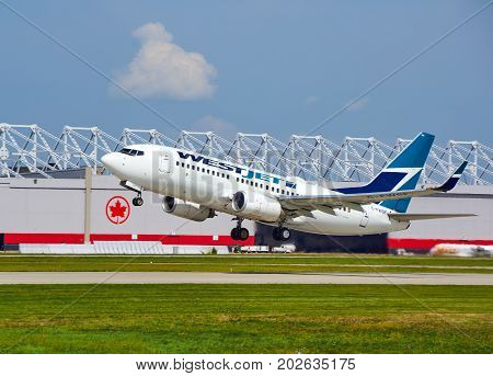 MONTREAL CANADA - AUGUST 28 2017 : WestJet C-FWSF Boeing 737 taking off. WestJet Airlines Ltd. is a Canadian airline founded in 1996.