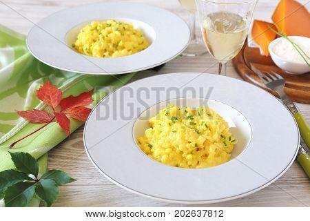 Saffron risotto with Mimolette cheese onion shallot plant and white wine