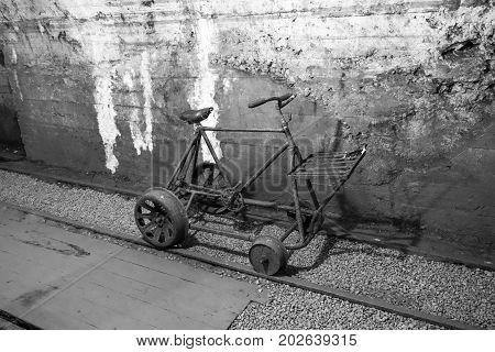 Mining tunnel interior with biccycle on tracks