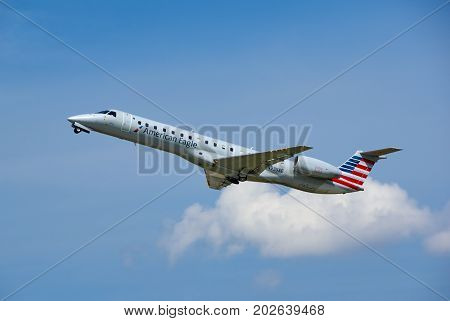 MONTREAL CANADA - AUGUST 28 2017 : American Eagle N935AE EMBRAER EMB-145LR taking off. American Eagle is an American brand name for the regional branch of American Airlines