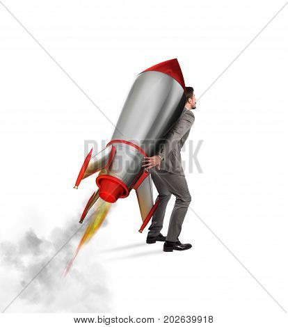Businessman holding a missile on his shoulders, isolated on white background