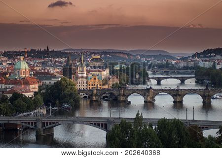 A view on the Prague bridges over Vltava river. Charles bridge Jirasek bridge Legion bridge. National theater Vysehrad church and hill and Zofin island in the background.