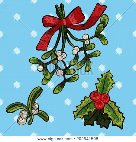Embroidery christmas patches with mistletoe. Vector embroidered floral elements for fashion design.