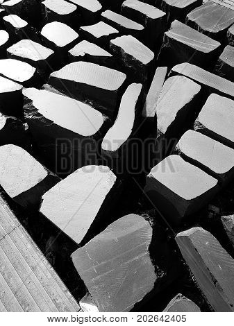 Stones On A Pedestrian Street Creating Contrasting Light Patterns-  Monochrome