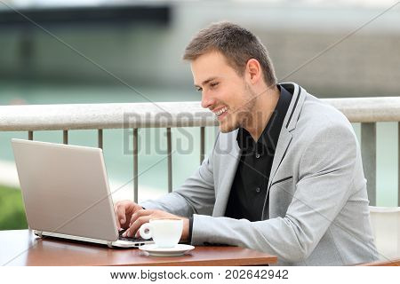 Executive Writing In A Laptop Outdoors