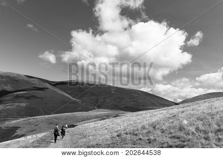 Hikers In Latrigg Overlooking Keswick And Lake Derwent Water, Cumbria