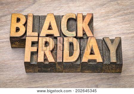 Black Friday banner  in vintage letterpress wood type blocks against grained wood