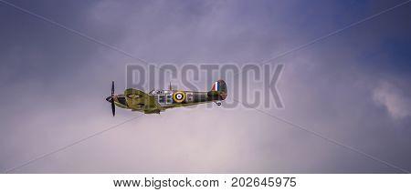 RAF FAIRFORD, UK - JULY 10 2016:: RAF vintage Spitfire Fly Past at the Royal International Air Tattoo July 18, 2010 in Fairford, United Kingdom