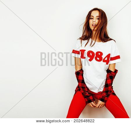 young pretty teenage hipster girl posing emotional happy smiling on white background, lifestyle people concept close up