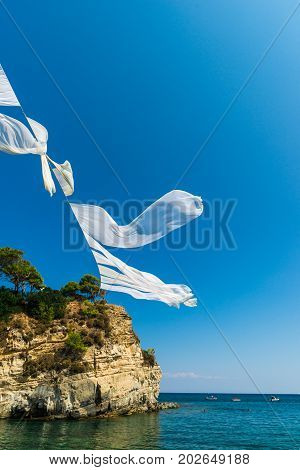 White sheets in the air in Zakynthos island, Greece