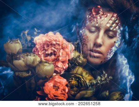 woman in creative image  with big flowers.