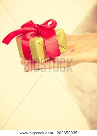 Female Hand With Golden Box Gift