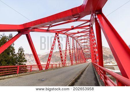 Red bridge across Chikuma River Nagano Japan