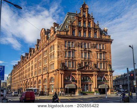 EDINBURGH, SCOTLAND - JULY 26: The landmark Caledonian Hotel on Princes Street on July 26, 2017 in Edinburgh, Scotland. The Caledonian is one of the most prestigious hotels in Edinburgh.