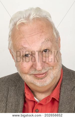 Elderly person smiling whimsically - on bright background