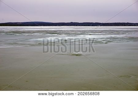 A view of ice-covered Little Traverse Bay, from the beach in Wequetonsing, Michigan, during March.