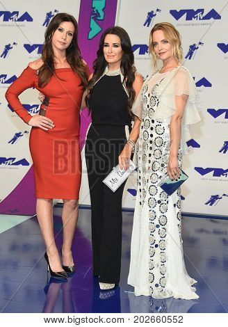 LOS ANGELES - AUG 27:  Jennifer Bartels, Kyle Richards and Mena Suvari arrives for the MTV Video Music Awards 2017 on August 27, 2017 in Inglewood, CA