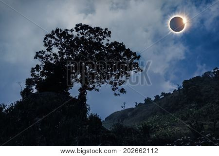 Scientific Natural Phenomenon. Total Solar Eclipse Glowing On Sky.