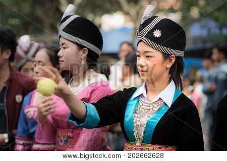 Luang Prabang, Laos - December 19, 2015: A woman of local mountaineer tribe 'Hmong' is dressing with traditional costume in Luang Prabang, Laos.