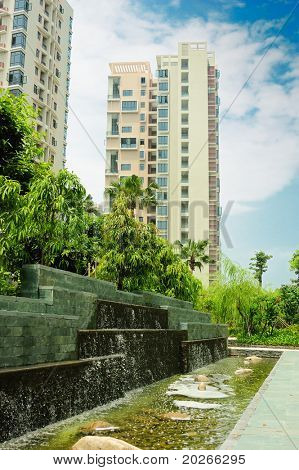 Building and man made multi-steps water fall in a new Chinese residential district.