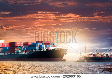 Logistics import export background of Container Cargo ship in the ocean at sunset sky Freight Transportation