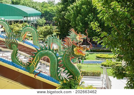 statue of green dragon on the handrail in temple