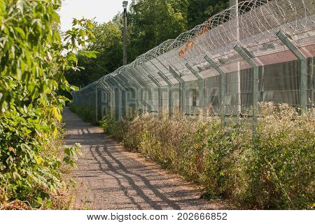 Long Fence With Barbed Wire, Restricted Area,