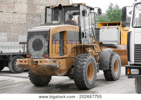 Excavator on the territory of concrete batching plant