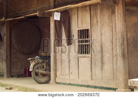 Old wooden house of poor people at countryside in Asia, simply life
