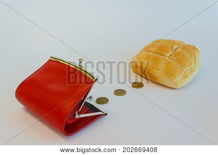 a purse containing cents to buy a loaf of bread /the cost of a loaf of bread