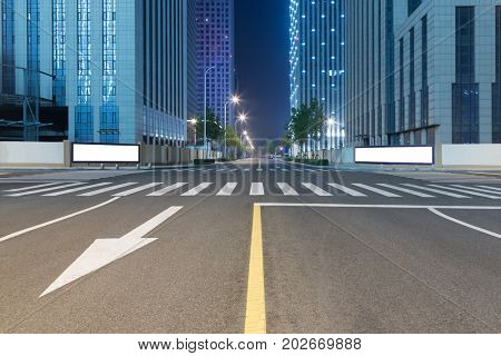 empty road and modern office block buildings against sky,Tianjin,China.