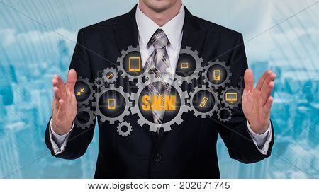 Business technology internet and networking concept. SMM - Social Media Marketing on the virtual display.