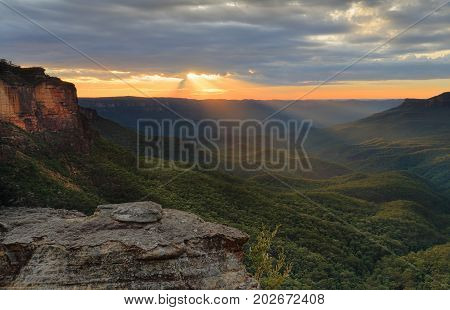 Wonderful sunrise in the Blue Mountains from Katoomba sunrays stream into Jamison Valley