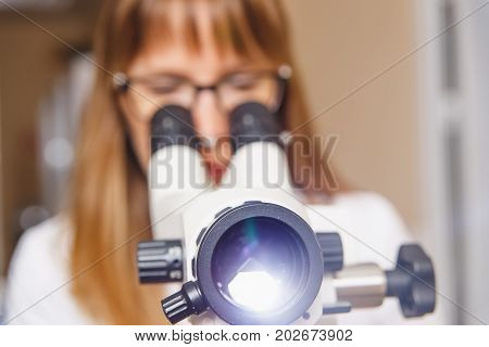 Woman Gynecologist Working With Colposcope