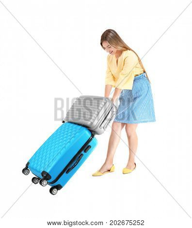 Young woman carrying luggage on white background. Luggage overweight concept